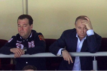 Putin and Medvedev watching a little hockey. (Sasha Mordovets)